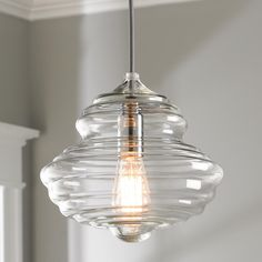 """Closed Bell Glass Pendant This charming pendant comes with clear glass and chrome socket cover and canopy. 130"""" max height. 2.65 lbs. (10""""Hx10.5""""W). 60 watts medium base socket."""