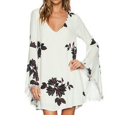 Free People Wanderer Dress Gorgeous free people dress. It is more of a cream and dark red/purple than what shows in the pictures. Free People Dresses Long Sleeve