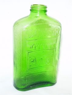 Hemingray Green Depression Glass  Refrigerator Bottle from MuleWagon.com  This Green 1 Qt. Refrigerator Bottle is marked Hemingray , 1 Qt. , Sept 15 , 1931 and has a Waterfall Design. This Hemingray Water Bottle is used in good condition with no chips or cracks. Hemingray Glass Company is known for being the largest manufacturer of Glass Insulators and started making Glass insulators for Lighting Rods in the 1850's.  $74.50