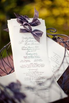Calligraphy and purple ribbon programs. Turquoise, pink or off white ribbon instead