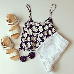 Gorgeous white denim shorts with top floral cropped blouse and cute ladies shoes and awesome black goggles the best way to show fashion