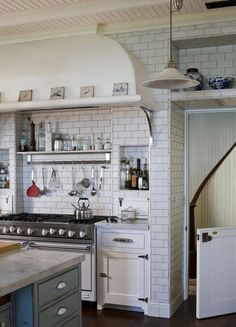 Dutch doors inside...to keep pets or children from going into certain areas...love the stove,shelves & niches!