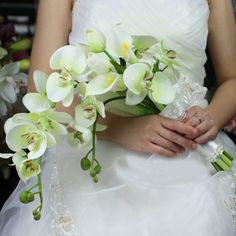 Real Touch Pure White 4 Calla Lily+3 Tulip+2 Phalaenopsis Ribbon Arch Moon Bridal Bouquet Wedding Decoration Artificial Flowers http://www.dhgate.com/product/real-touch-pure-white-4-calla-lily-3-tulip/179112365.html#s1-38-1|1107715700