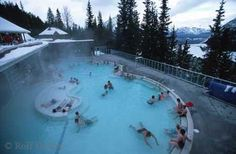 Banff Upper Hot Springs  Enjoy a leisurely soak in the Upper Hot Springs pool in Banff National Park, Alberta, Canada while gazing out at the snow capped mountain tops of Mount Rundle.