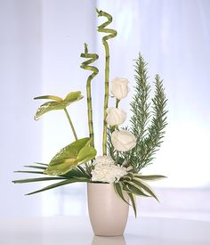 floral arrangements for home modern | Flower arrangement in white and green in a container. Modern and fresh ...