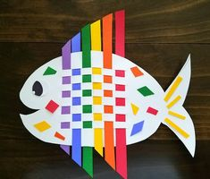 Weaving Rainbow Fish This colorful fish is a fun way to introduce kids to weaving. All you need is construction paper. The post Weaving Rainbow Fish was featured on Fun Family Crafts. Ocean Kids Crafts, Summer Crafts For Kids, Art For Kids, Summer Fun, Kids Diy, Craft Activities, Preschool Crafts, Fun Crafts, Arts And Crafts