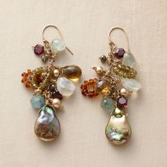 """Anchored by olive baroque cultured pearls, these dramatic danglers combine aquamarine, vessionite, whiskey quartz, orange citrine, pyrite, pink garnets and 14kt goldfilled sandblasted beads. French wires. Handmade in the USA. 2-1/2""""L."""
