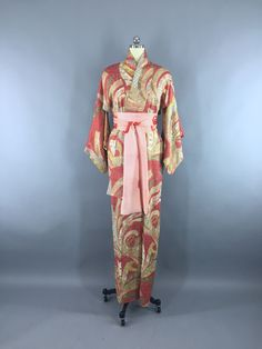 Stunning vintage 1940s silk kimono robe with an intricate and tiny dotted floral pattern and hand painted gold accents. The print is in shades of red, green, gold, and blue, see the close up photo. It