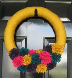 Yarn pom-pom wreath by my friend, Rebecca.