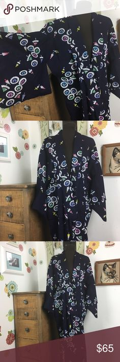 """Kimono Robe Watercolor Parasol Novelty Print Gorgeous cotton or cotton blend kimono with a sweet little parasol or umbrella print. The navy blue robe features white umbrellas with splotches of color to highlight them. There are no tags on this and it has no tie. There is a single hook and eye closure at the waist. The robe measures 50"""" at the chest, is 55"""" long, and the three quarter sleeves hang 17.5"""" long.  Inventory 21 Vintage Intimates & Sleepwear Robes"""