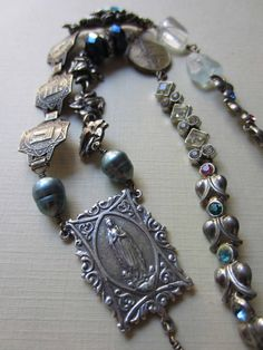 Vintage Catholic Jewelry and Medals. I LOVE Rosaries even if I am not Catholic, especially old ones or special hand made ones.