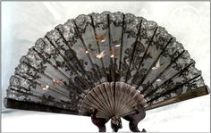 Vintage French Fan Made Of Black Lace, Gauze, Hand Carved And Pierced Ebony Sticks And Guards And Hand Painted Birds In Flight And Graceful Fragile Spreading Foliage   c. 1940