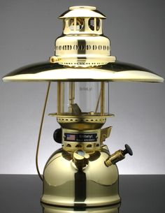 Polished brass lantern with top reflector