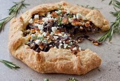 There's a lot to love in this galette from the flakey sour cream pastry to the mushrooms deglazed with sherry to the tangy, ripened goat cheese.