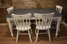 Farmhouse Solid Pine Dining Table with Graphite Top & 4 Solid Oak Chairs , top of the table is chalk painted and waxed . Hanging hearts included . Measurements 151cm x W 91cm x H 74.5cm LOCAL DELIVERY AVAILABLE Please contact us for more details