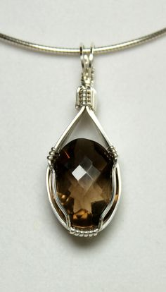 OOAK Handmade Reiki Infused Healing Crystal Pendant: Sterling Silver Wire Wrapped Faceted Smokey Quartz. $74.00, via Etsy. www.etsy.com/shop/SolaraHealingArts