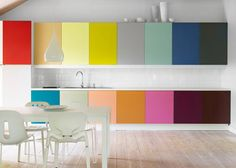 These rainbow cabinet doors are amazing. They add energy and light to this simple white palette without making the room too cluttery.
