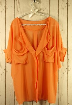 Orange Over-sized Top with Front Drape Pockets.