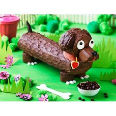 Frankfurt the sausage dog cake recipe - By Australian Women's Weekly, Calling all little dog lovers! Frankfurt, the sausage dog is a delicious and easy chocolate covered sponge roll. Don't forget to add his bowl of M&M's dog food!