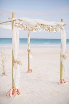 Love this tropical beach wedding arch!  Rumours Luxury Villas and Spa - Rarotonga. For your luxury wedding and honeymoon www.rumours-rarotonga.com