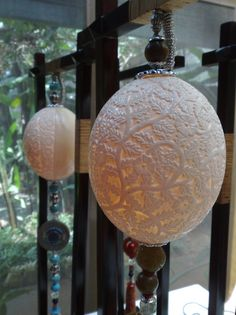 Carved ostrich eggshell suspended lamp