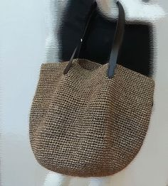 This raffia bag is very stylish and pretty. I crocheted it with royal raffia yarn that sold in my shop. Handles are genuine leather. It is light and soft. Perfect as a carry all bag . Bring it to the beach is wonderful! Three colors you can choose.If you want other colors,just leave me a