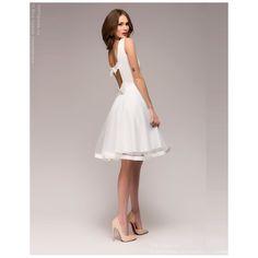 Белое платье-мини с бантиками на спине