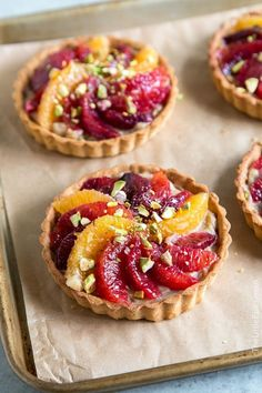 Blood Orange Earl Grey Tarts: little pte brise tart shells filled with earl grey pastry cream and topped with blood orange segments and crushed pistachio