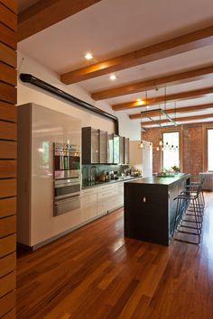 Industrial chic loft with open-plan interiors in NoHo  by architecture studio JENDRETZKI LLC