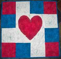 """Playful heart wall hanging or table topper measures 22"""" x 22""""."""