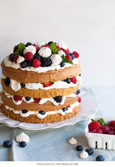 Mess Cake - Inspired by the classic dessert, this cake combines crisp meringues, sweetened cream, fresh berries - layered between an airy sponge cake. | By Tessa Huff for TheCakeBlog.com