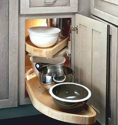 Kitchen cabinet organizers - solid-wood Lazy Susan easily makes the most use of corner storage space and keeps things organized and accessible