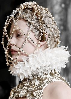 Frida Gustavsson walking Alexander McQueen FW 2013 by Sarah Burton, her hair is in a modern day snood.