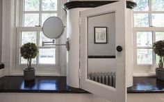 Inside the homes of Philly's interior designers | PhillyVoice.   deep sills and elegant curves give this medicine cabinet a look of substance.   Bathroom designed by Amy Cuker of down2earth interior design.