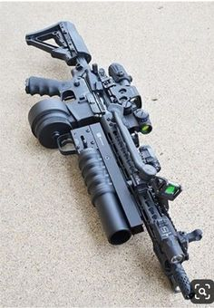 3 red dot sights a bipod a launcher and the worst drum mag ever. I hope this was a joke Airsoft Guns, Weapons Guns, Guns And Ammo, Zombie Weapons, Armas Wallpaper, Armas Ninja, Battle Rifle, Future Weapons, Custom Guns