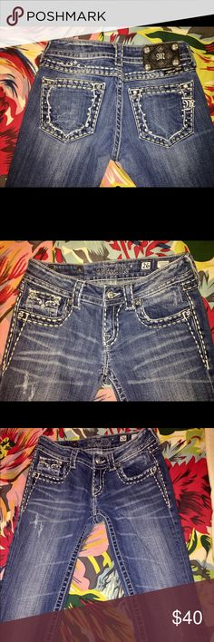 Holly designed rhinestoned Miss Me Jeans size 26!! Adorable embellished Miss Me jeans!! Boot cut, med-dark wash, size 26, preloved!! a little wear at bottoms of feet on the back and 1 missing unnoticeable jewel. Great jeans!!! inseam is 32 inches!! Miss Me Jeans