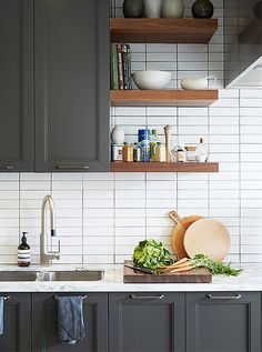 Peek Inside Bon Appétit's New Dream Kitchen Open shelving (custom made by the architectural firm Gensler) provides easy access to frequently used ingredients (and pretty objects), freeing up counters.Custom Custom may refer to: Kitchen Cabinetry, Kitchen Shelves, Kitchen Tiles, New Kitchen, Kitchen Dining, Kitchen Decor, Dark Grey Kitchen Cabinets, Nordic Kitchen, Gray Cabinets