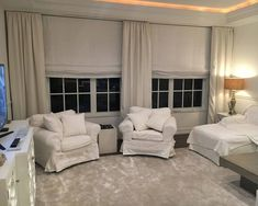 white-linen-roman-shades-and-panels
