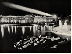 Agricultural Building at Night, from North West. With spotlight or beacon of light shining across the lagoon Large photographic print from The White City (As It Was). Photographs by William Henry Jackson. World's Columbian Exposition. 1893.    Digitial