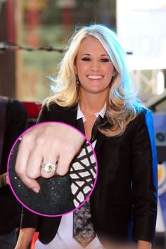 Carrie Underwood is one lucky lady!  The country sweetheart scored a flawless yellow diamond Johnathon Arndt ring from hockey stud Mike Fisher, worth about $150,000.