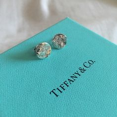 "Tiffany and Co. ""Notes Collection"" studs ✨AUTHENTIC✨ purchased myself at a Tiffany and co store. Pre-owned and loved, comes with original earring backs that say T&Co 925. Everything is 100% authentic. Hallmark stamp on stick. These earrings are from the ""Notes Collection"". A little dirty, needs some polishing. Please refer to pictures. Does come with pouch and box. Tiffany & Co. Jewelry Earrings"