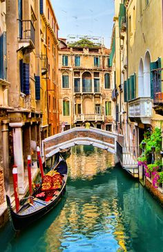 Scenic view of gondola on a canal, Venice, Italy
