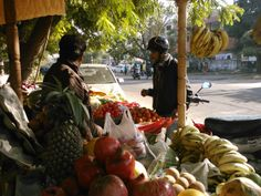 """Amazing fresh fruit and vegetables from street vender in Jaipur, India. Buying one Kantha Scarf enables a family to buy 2 bags of fresh potatoes, cauliflower, eggplant, bananas, oranges, onions and lemons. Delicious and nutritious. Suppport """"Women Helping Women"""" co-op."""