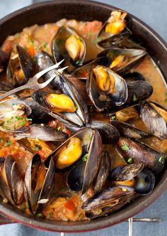 Mussels in White Wine Sauce with Onions and Tomatoes(maybe skip the tomatoes...)
