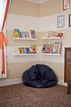 Love the idea of a little book nook...lower shelves, though. More comfy pillows and bean bags!