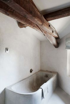 Smooth white walls and a simple concrete bath combine with wooden beams in the modern rustic bathroom Bad Inspiration, Bathroom Inspiration, Interior Inspiration, Bathroom Ideas, Bathroom Gallery, Bathroom Trends, Bathroom Renovations, Interior Ideas, Modern Interior