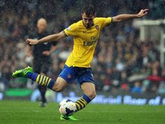 Arsenal's Welsh midfielder Aaron Ramsey shoots during the English Premier League football match between Fulham and Arsenal at Craven Cottage in London on August 24, 2013. Arsenal won the game 3-1.