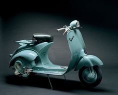 "Vespa 125 U, 1953 - The ""Utility"" version with spartan styling, which sold at 20,000 lire less than the more modern 125. The headlamp appeared high up on the handlebar for the first time in Italy (it had already been introduced on a number of exported models)."