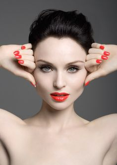 I love how the lip color and nail color are the same. I also adore when someone's eye color and nails match,