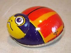 This is a Vintage 1960s Tin Friction Ladybug Toy.